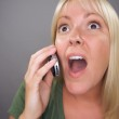 Stunned Blond Woman Using Cell Phone — Stock Photo