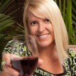 Beautiful blonde Toasts with red wine — Stock Photo