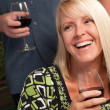 Stock Photo: Wine Drinking Blonde Socializes at party