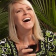 Beautiful blonde laughs at a Party — Stock Photo
