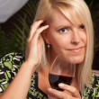 Beautiful Blonde Smiling with Wine Glass - Stock Photo