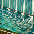 Row of Cruise Ship Lounge Chairs Abstract Image - Stock Photo