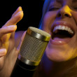 Woman Sings with Passion — Stock Photo #2345411