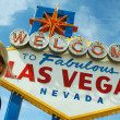 Blonde Girl in Front of Las Vegas Sign - Stock Photo