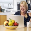 Stock Photo: WomUsing Laptop for E-commerce