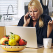 Confused Girl on Cell Phone & Laptop — Stock Photo
