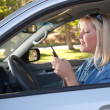 Stockfoto: WomText Messaging While Driving
