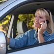 Woman Using Cell Phone While Driving — Stock Photo