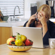 Stressed Woman Using Phone and Laptop — Foto Stock