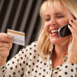 Woman with Credit Card on The Phone — Stock Photo #2345867