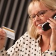 Woman with Credit Card on The Phone — Stock Photo