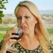 Something in My Wine! - Stock Photo