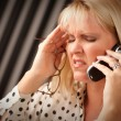 Stressed Woman Using Cell Phone - Foto Stock
