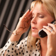 Stressed Woman Using Cell Phone - Stock Photo