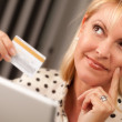 Woman on Her Laptop Holding Credit Card — Stock Photo