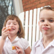 Sister and Brother Having Fun Eating an Apple — Stock Photo #2346684