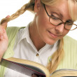 Female With Ponytails Reads Her Book — Stock Photo