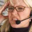 Woman with Phone Headset and Headache — Stock Photo #2346891