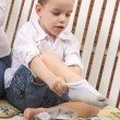 Adorable Young Boy Getting Dressed Putting His Socks On — Stock Photo #2346998
