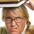 Irate Woman with Her Books on Her Head — Stock Photo