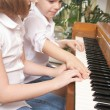 Brother and Sister Playing the Piano Together — Stock Photo #2347080