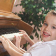 Brother and Sister Playing the Piano Together — Stock Photo
