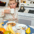 Attractive Woman In Kitchen with Fruit, Coffee, — Stock Photo #2347171