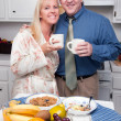 Stock Photo: Happy Woman and Businessman In Kitchen