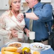 Stressed Couple Checking Time in Kitchen - Foto de Stock  