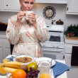 Attractive Woman In Kitchen with Fruit, Coffee, — Stock Photo #2347249