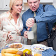 Stressed Couple Checking Time in Kitchen — Stock Photo