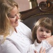 Young Mother and Daughter Brushing Hair — Stock Photo