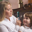 Young Mother and Daughter Enjoy Grooming — Stock Photo #2347450