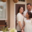 Hispanic Family in Front of New Home — Stock fotografie