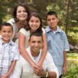 Happy Hispanic Family In the Park — Stockfoto
