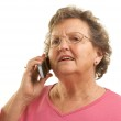 Senior Woman Using Cell Phone on White — Stock Photo