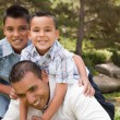 Father and Sons in the Park - Stock Photo