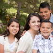 Happy Hispanic Family In the Park — Stock Photo #2347767