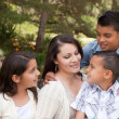 图库照片: Happy Hispanic Family In the Park