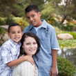 Happy Hispanic Mother and Sons in Park — Stock Photo