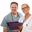 Male and Female Doctors Looking at File — Stock Photo