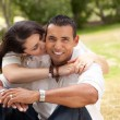 Happy Hispanic Couple in the Park — Stockfoto