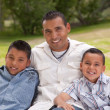 Hispanic Father and Sons Portrait in the — Stock Photo