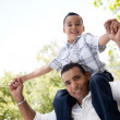Royalty-Free Stock Photo: Hispanic Father and Son Having Fun in the Park