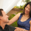 Hispanic and Caucasian Couple Flirting - Stock Photo