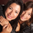 Attractive Hispanic Mother & Daughter Studio Embrace — Stock Photo