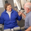 Stock Photo: Senior Couple Working Out in the Gym