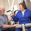 Senior Couple Working Out in the Gym — Stock Photo #2348691