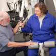Royalty-Free Stock Photo: Senior Couple Working Out in the Gym
