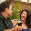 Royalty-Free Stock Photo: Attractive Hispanic and Caucasian Couple Enjoy Wine